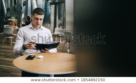 young man with agenda having a break Stock photo © photography33