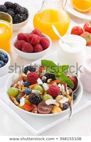 Stockfoto: Vruchtensalade · sinaasappelsap · voedsel · vruchten · banaan · salade