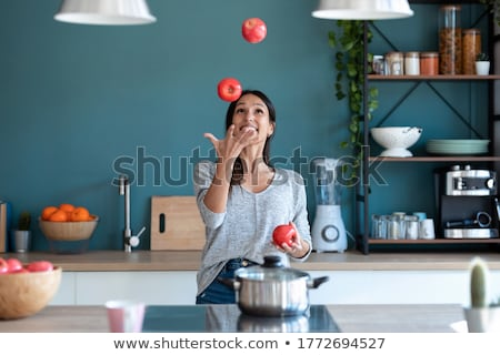Jovem morena malabarismo fresco maçã retrato Foto stock © lithian