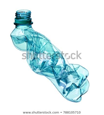 close up of a white plastic bottle on white background stock photo © ozaiachin