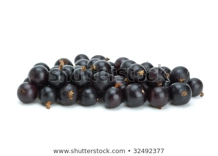 Stock photo: Small pile of blackcurrant berries
