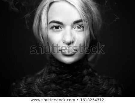elegant blonde woman smoking a cigarette stock photo © pawelsierakowski