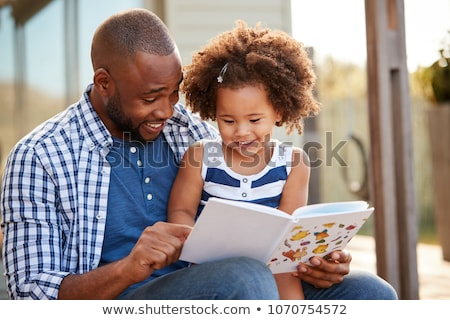 Father and daughter reading book Stock photo © photography33