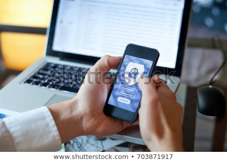 businessman with shield and laptop internetcomputer security concept stock photo © kirill_m