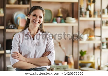 Stock photo: Portrait of a cheerful artisan