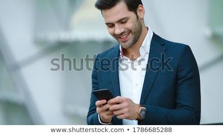 confident young businessman stock photo © lithian