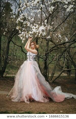 小さな ブロンド 女性 香ばしい 庭園 春 ストックフォト © konradbak