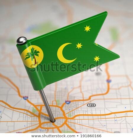 Cocos (Keeling) Islands Small Flag on a Map Background. Stock photo © tashatuvango