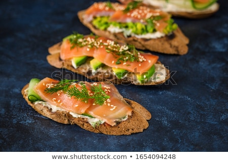 Appetizer of smoked salmon, cucumber and cream cheese stock photo © raphotos