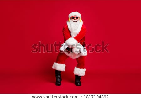 Santa Claus is listening music stock photo © HASLOO