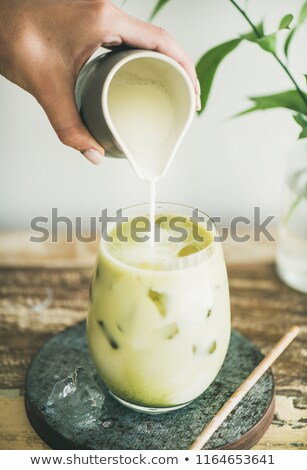 close up fresh iced coffee latte in glass pitcher stock photo © nalinratphi