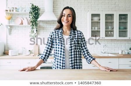 женщину кухне питьевой кофе рабочих ноутбука Сток-фото © zdenkam