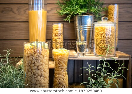 Dried pasta tubes in a glass jar Stock photo © raphotos