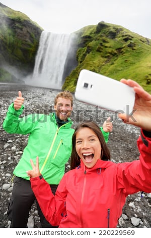 selfie couple taking smartphone picture waterfall stock photo © maridav