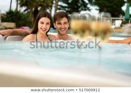 yüzme · havuzu · mutlu · insanlar · dinlenmek · genç · kadın - stok fotoğraf © kurhan