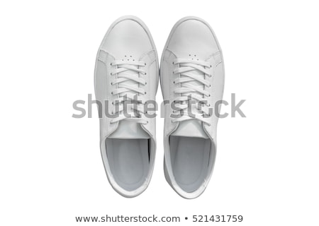 Pair of Worn White Sneakers on White Background Stock photo © ozgur