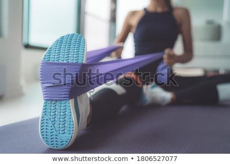 Pilates nő láb húzás hát testmozgás Stock fotó © lunamarina