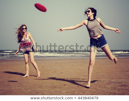 woman playing frisbee stock photo © rastudio