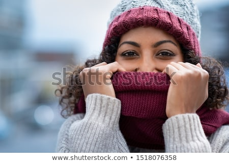 attractive young woman hiding her face with a scarf stock photo © andreasberheide