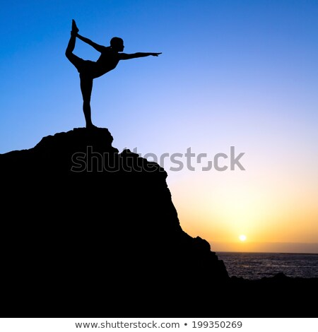 Woman in the dancer yoga pose meditating at sunset. Zen Stock photo © photocreo