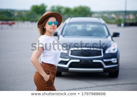 Nő fekete ruha pózol autó parkolás vonzó Stock fotó © deandrobot