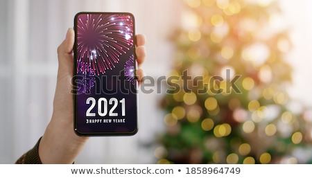 merry christmas and happy new year message on mobile phone stock photo © stevanovicigor