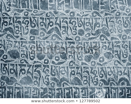 Painted Tibetan Script Carved Stone Stock photo © pancaketom