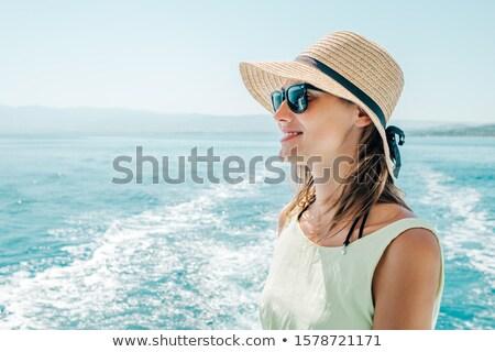 Vonzó nő visel kalap áll jacht fotó Stock fotó © deandrobot