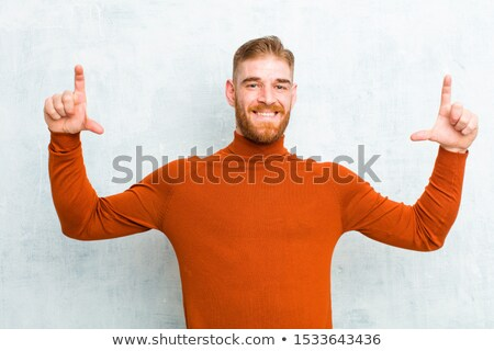 relaxed fashion man holding both hands on neck  Stock photo © feedough