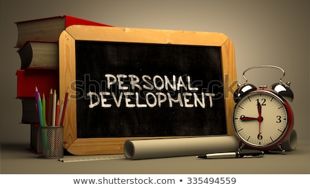 handwritten personal development on a chalkboard stock photo © tashatuvango