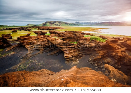 Sandy rocks with by magma formed by winds. Location Sudurland, c Stock photo © Leonidtit