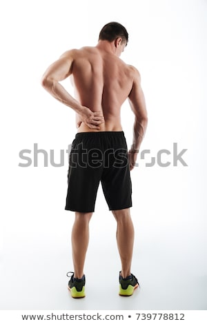 Sad young sportsman have a painful feelings in body. Stock photo © deandrobot