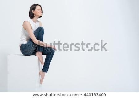 Vonzó fiatal nő ül zsámoly stúdiófelvétel vár Stock fotó © filipw