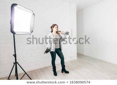 dslr camera on tripod shooting brick wall stock photo © jirkaejc