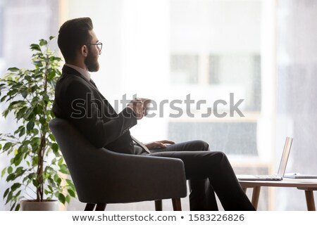 Businessman pondering Stock photo © IS2