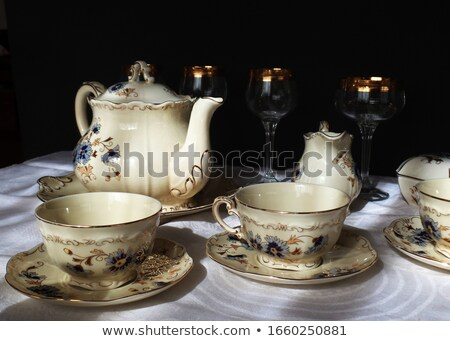 set of rimmed plates, bowls and glasses Stock photo © Digifoodstock
