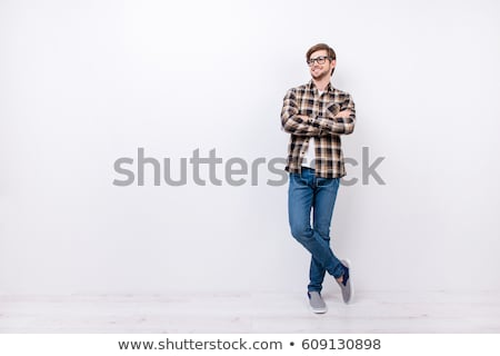 full length portrait of a happy bearded guy stock photo © deandrobot