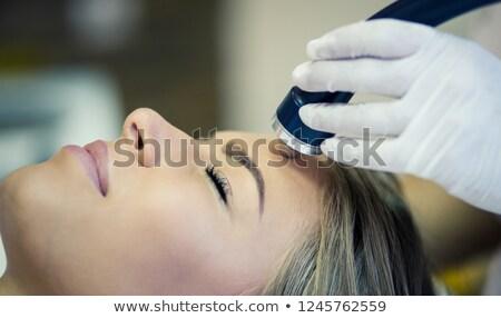 Smiling woman having sound massage  Stock photo © Kzenon