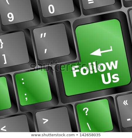 Follow Us on Blue Key of Laptop. 3D. Stock photo © tashatuvango