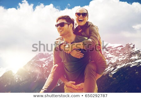 happy woman with backpack over alps mountains Stock photo © dolgachov