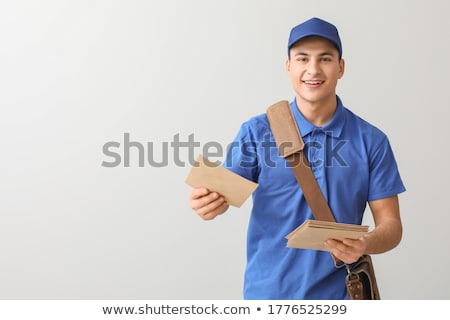 Postman with bag delivering letters Stock photo © jossdiim