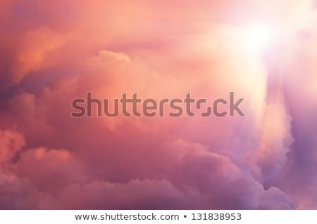 Background sun coming into pink clouds Stock photo © galitskaya