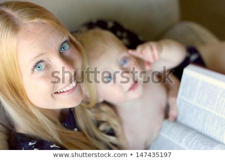 Young mother reading a novel with her kids Stock photo © konradbak