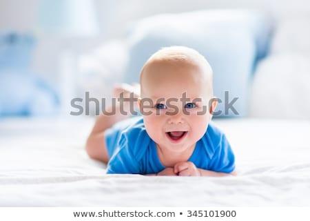 Сток-фото: прелестный · ребенка · мальчика · белый · спальня · утра