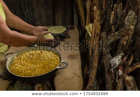 Cooks making dough for Tortillas on a kneading trough. Stock photo © Photooiasson