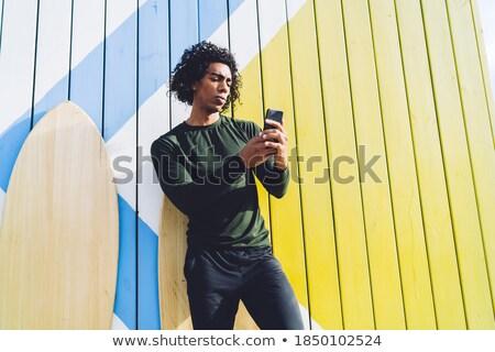 férfi · okostelefon · tengerpart · napos · idő · telefon · tenger - stock fotó © deandrobot
