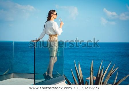 Mujer vidrio champán mar pie Foto stock © Kzenon