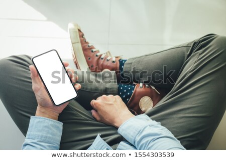 Digital marketing concept. Man sitting on the floor and holding lap top in his lap and working. Flat Stock photo © makyzz