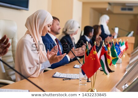 Group of contemporary intercultural delegates clapping hands Stock photo © pressmaster