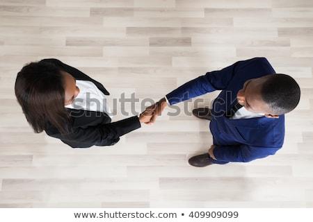iki · ortaklar · anlaşma · el · sıkışmak · ayakta · ofis - stok fotoğraf © andreypopov